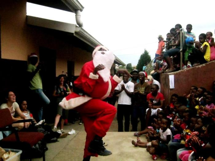 Baba Christmas (as Father Christmas is called here) dancing for the kiddies.