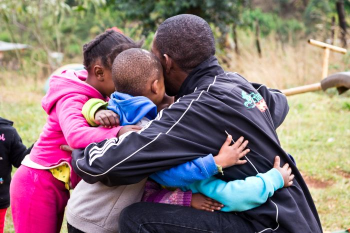 Nathi M is greeted by a hug when he arrives at Life Group.