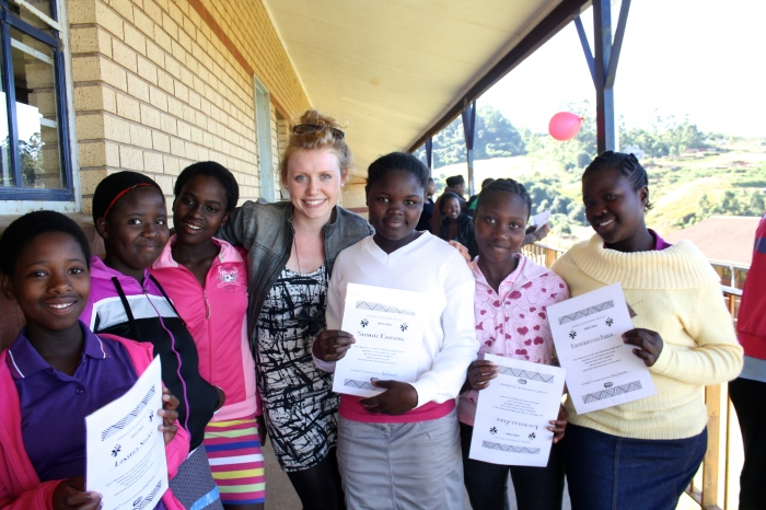 Anna with some of her students, and their certificates