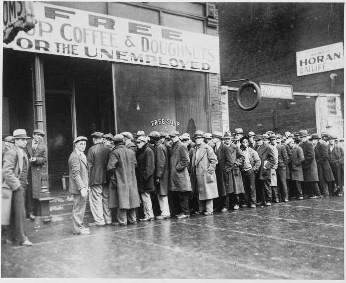 Unemployed_men_queued_outside_a_depression_soup_kitchen_opened_in_Chicago_by_Al_Capone,_02-1931_-_NARA_-_541927.jpg