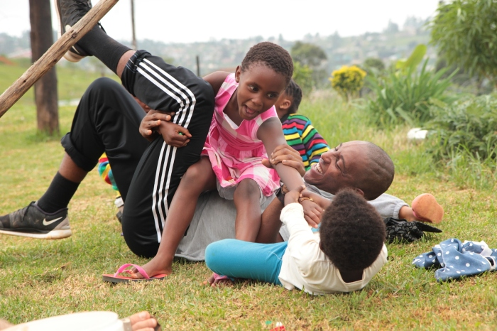 Nothing like some tickle-tackle time at Life Group with iThemba mentor Mashinini
