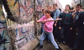 The Berlin Wall falling.