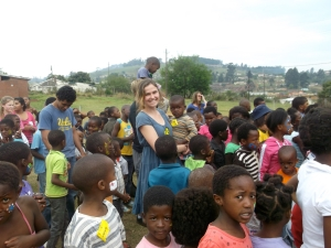 Volunteer Sarah, from Trinity, in the sea of children during song time. :)
