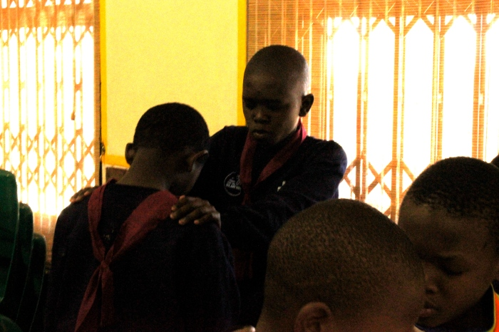 Kids praying with each other during worship