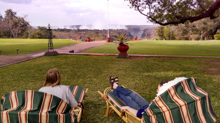 Us at Victoria Falls hotel, where we had high tea-- you can see the smoke from the falls, even much further away than this.