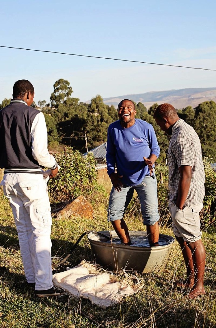 Sizwe shares a laugh with some of his Life Group boys. (He's in a very cold bucket  of water, because it was an object lesson on faith).